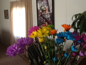 My flowers with our epic Avengers art in the background